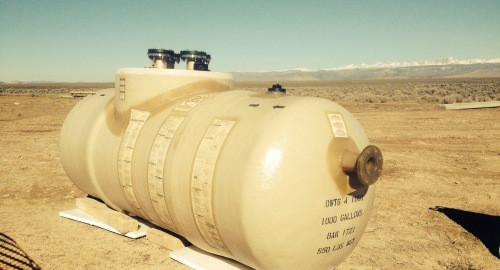 Underground double-wall Containment Solutions tank being installed for waste oil storage in Wyoming