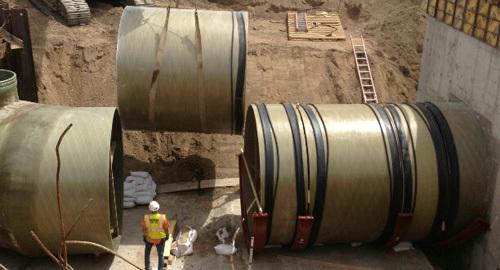 Twelve foot diameter Belco fiberglass pipe being installed in Denver Water Treatment Plant.